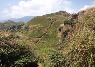 Západní vrchol hory Qixingshan v národním parku Yangmingshan