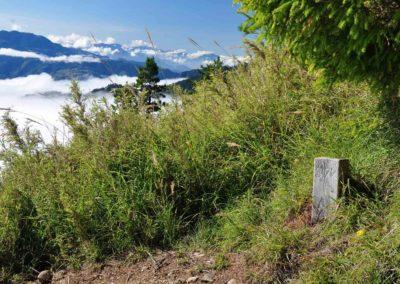 Turistické značení na stezce na horu Xueshan v národním parku Sheipa